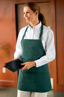 A woman wearing a bib apron